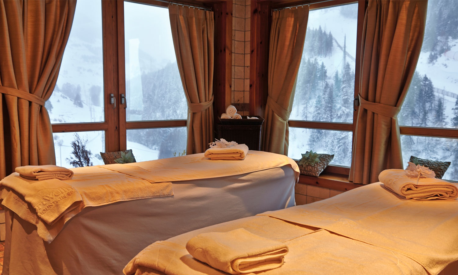 Hermitage Mountain Residences Andorra Sport Wellness Mountain Spa cabines de tractaments de bellesa i massatges con vistes a Grandvalira